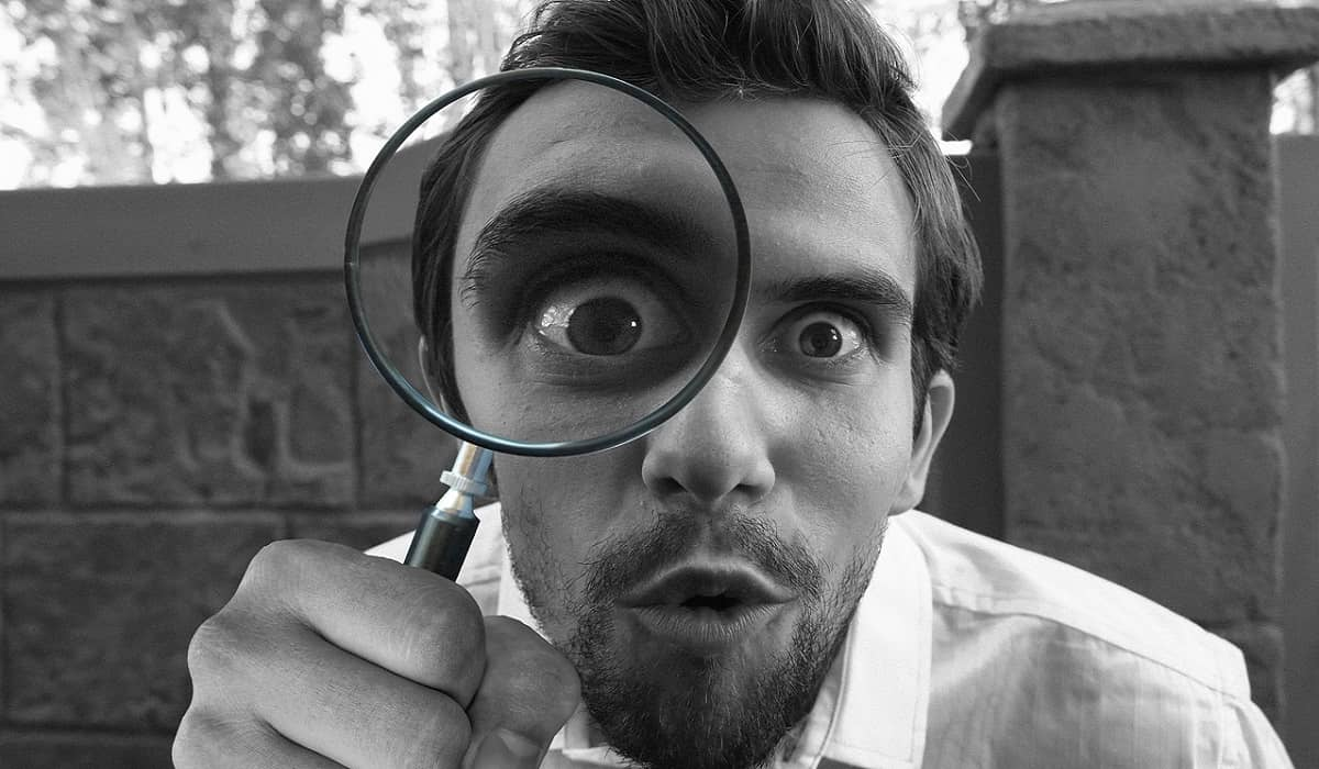 a man with magnifying glass